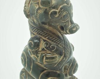 A Han dynasty brown jade ram beast.