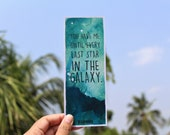 Illuminae quoted bookmark with water-colour painted background