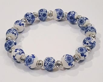 Floral Blue and White Ceramic Beaded Stretch Bracelet with metal accent beads, China ceramic/Russian Gjel style