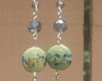 Hand made bead and feather earrings.
