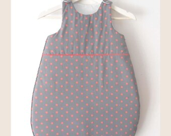 Gray sleeping bag with orange dots on order