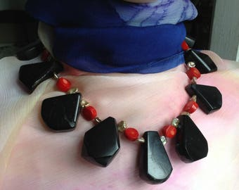 A very special black, red, beige handmade necklace of ancient jet, bambou de mer, and keshi with yellow copper coloured nickelfree clasp