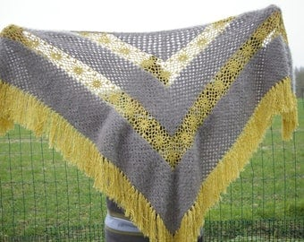 Gray shawl with lurex crocheted by hand.