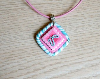 Unique hand made polymer clay pendant with hieroglyph