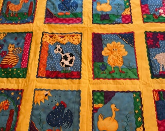 Baby quilt & crib sheet in primary colors