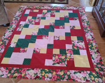 This quilt top is made from pretty rose fabric