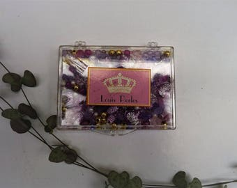 1 box of mix of pink purple white synthetic pearls