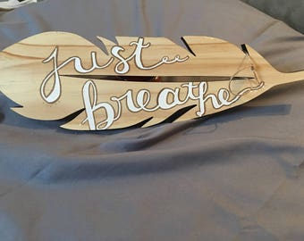 """Feather wall decor with handwritten calligraphy .."""" just breathe"""""""