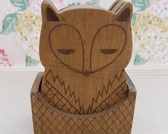 Vintage wooden fox coasters in holder, retro.