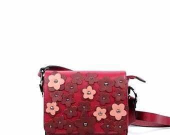 Appliquéd flowers shoulder bag