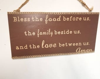 Bless the Food Before Us, The Family Beside Us, and THe Love Between Us.  Amen - wood sign