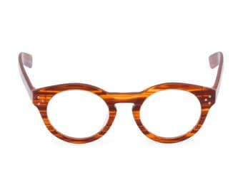 A spectacle of a spectacle, Handmade in fine Italian acetate, FLYNN in Amber, round designer eyeglasses. Heads will turn!
