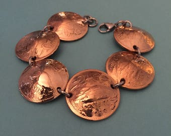 Coin Bracelet handmade. From Vintage  Large Mexican Coins.   Total length 8 1/2 inches. The coins are half dollar size.