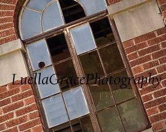Broken window abandoned building