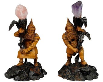 a pair of wooden carved black forest dwarfs with crystal stones