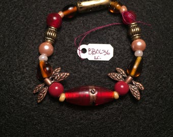 Red Beaded Bracelet with Dragonfly Wings
