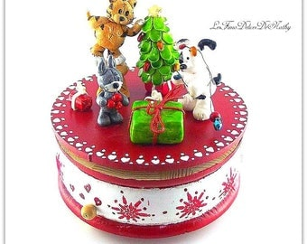 Creation is handmade polymer clay the 3 little friends animal music box celebrating Christmas