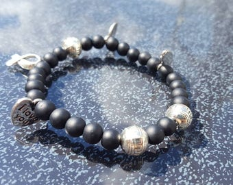 Handmade bracelet in black and silver with charms