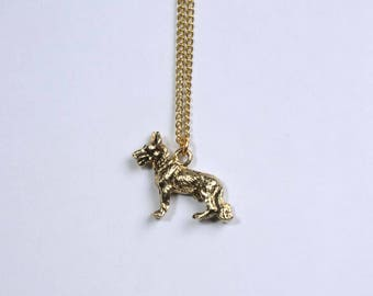 "Vintage had cast 24K gold and Nickel plated Shepherd body 18"" pendant necklace."