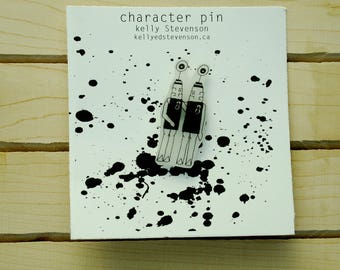 Hand holding character pin