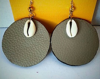 Genuine leather earrings with cowrie shell embellishment