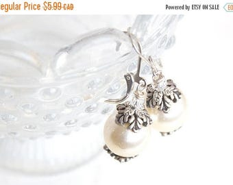 Sale silver and cream pearl earrings.