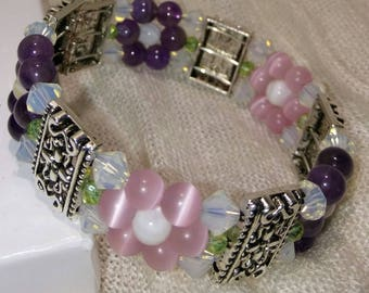 Stunning floral bracelet. Pink & Purple cuff bracelet. Free pair of earrings with any purchase!