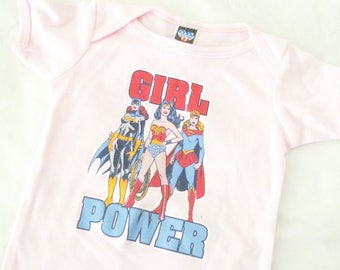 Girl Power One Wonder Woman, Batgirl, Super Girl, DC Comics Pink Baby Girl outfit. Unique Baby Shower gift idea. Brand new with original tag