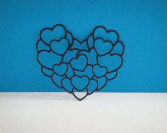 Cutting multiple black hearts for scrapbooking and card