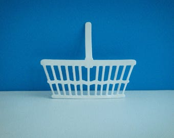 Cut white vinyl for scrapbooking and card basket
