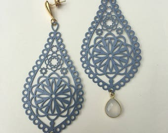 Blue jean colored metal earrings.