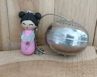 Gray and pink KOKESHI in polymer clay tea ball