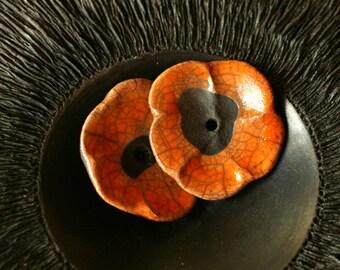 Terracotta flowers - orange on black background - set of 2 -