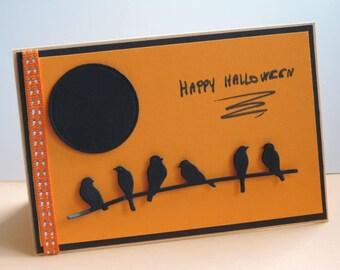Happy Halloween card, orange and black: Moon and birds.
