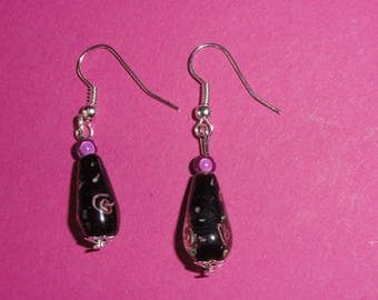 Pink earrings made of black glass flower beads
