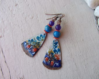 Dangling earrings with triangle charm in copper enameled with flowers in shades of bright, glass and jade, purple, blue and Red