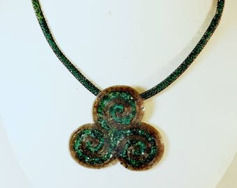 Green triskelion necklace
