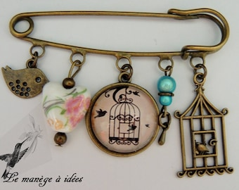 "Bronze metal brooch pin/cabochon ""pretty bird cage and bird""."