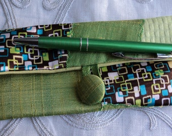Clutch in shades of green glasses case