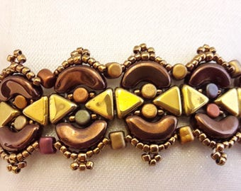 A... DOR... ABLE... chocolate and gold bracelet!
