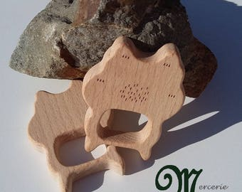 Natural wooden teething ring. Robot shape.