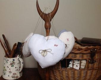 Heart hanging in white hemp, old coin, GS Monogram