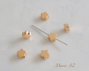 6 beads 6 mm - gold color copper stars