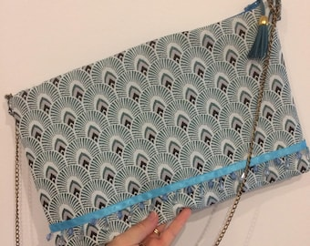 Handmade clutch purse has chain