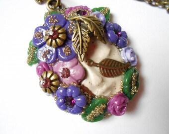 Necklace Bronze face future flower ceramic face.