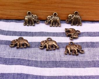 4 pendants charms small elephants, bronze, 3 D.