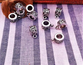 10 bails decorated with aged silver hearts