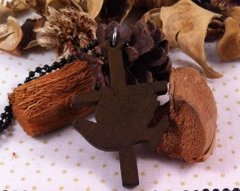 beautiful wooden cross finely decorated with a dove in the cross