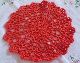 orange flower doily