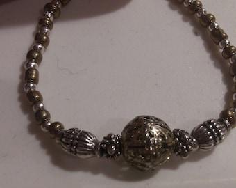 Gold and bronze metal beaded bracelet